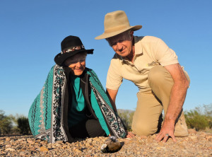Jeannette & David crouch down to watch dung-beetles