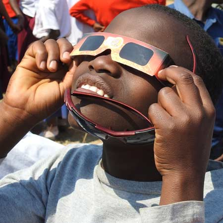 Boy views eclipse through special glasses