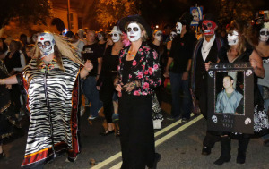 Costumed participants in All Souls Procession march through Tucson